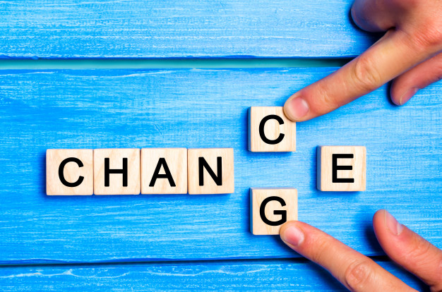 wooden cube with the word change